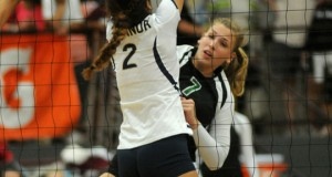 Madison Drescher, named the tournament's Outstanding Hitter, unloads against the O'Connor block. (Photo by Jerry Baker)