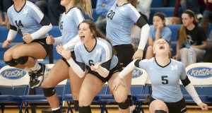 The Mercy bench erupts after the final point is scored at the Kentucky state championships on Sunday