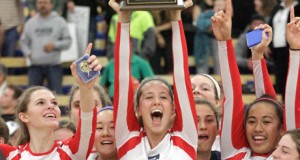 Senior Abril Bustamante, a four-year Sea Hawk, raises aloft the state championship trophy. Photo by Ray Vidal