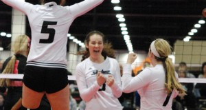 Hannah Puddy (3) celebrates her championship-winning kill with teammates Lauren Evans (5) and Keely Andrews