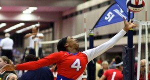 LoneStar's Karrington Jones (4) stretches for the kill during 15 Open action.