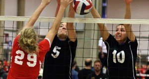 TAV's Payton Cabrera (5) and Madison Goings (10) duel at the net with Excel's Katherine Patton (29) in 16 Open action.