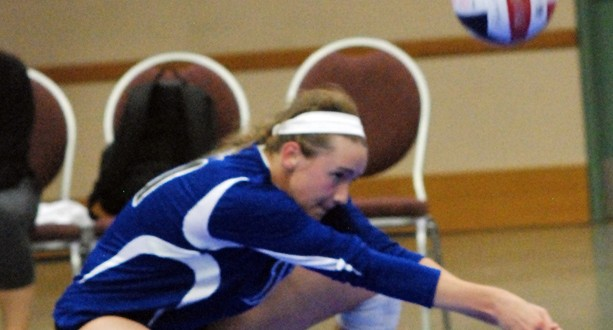 Rylee Neigenfind shows her digging form for Topeka Impact, which lost its first Gold pool match tonight in three sets