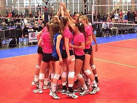 Coast 17 players join together with arms raised. It was a championship outing for the squad, after winning 17 Open at PNQ.