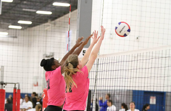 Coast 15s' Adiva Joseph, left, and Gabi Preciado go up for a block this season. Coast 15s is one of many responses we received from teams describing their seasons in one sentence.