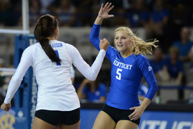 Ashley Dusek (5), Anni Thomasson and their Kentucky teammates had a great opening day, fending off Michigan State in five games. (UK Athletics)