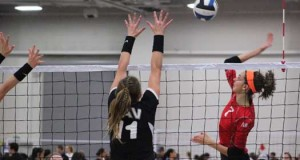 KiVA's Paige Hammons (7) goes against TAV's Bailey Downing (11).