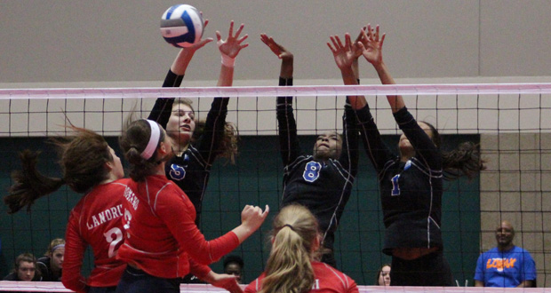 Munciana's Melanie Shaffmaster, blocking far left, is one of eight committed players from the Class of 2020 but like most isn't playing in the 15s Division this spring.