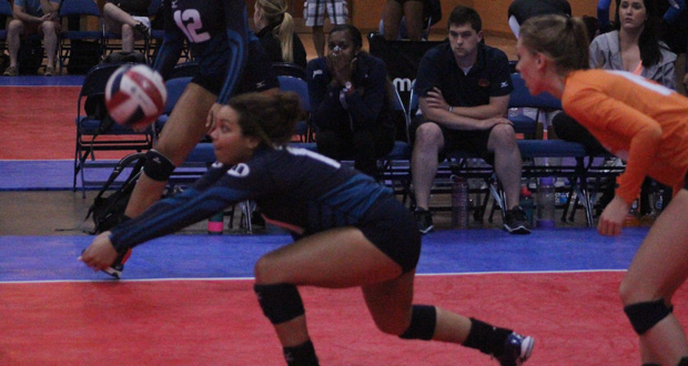 Mintonette 17s' Kristen Chatman with the pass during Day 1 action.