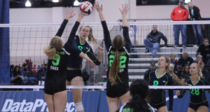 951 Elite's Amy Underdown (hitting) looks to beat the block during the 18 National championship match.