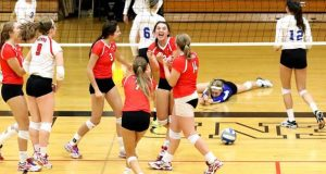 Neenah, in red, won the Sprawl on Saturday in Wisconsin, but it appears the Catholic Memorial libero (in purple) actually personified the event!