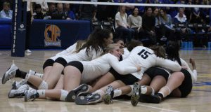 The dog pile is on after Archbishop Mitty's impressive play derailed Santa Margarita in the Open Division showdown for ultimate California bragging rights.