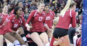 Stanford players rush the court after beating Minnesota and reaching the National Championship match.