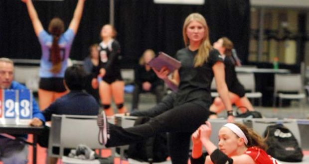 KiVA 15 Red coach Courtney Robison gets a kick out of this Savannah Neal dig. KiVA won 15 Open on Sunday
