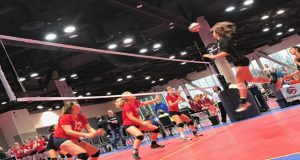 Lily Thomason of CoJrs 16Shannon readies for the kill in a straight-sets win over CB Elite in opening-match play Friday at the Spokane Convention Center.