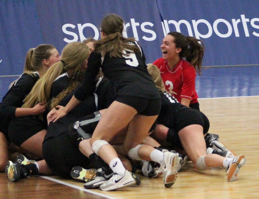 KC Power libero Izzy Enna (2) and the rest of her teammates join the dog pile after KC Power  captured the 18 Open gold medal.