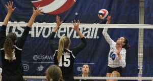 TAV's Madison Goings (10) challenges the block of KC Power during Sunday's 18 Open final.